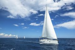 Sailing. Boat in sailing regatta. Luxury yachts. Travel. Royalty Free Stock Images