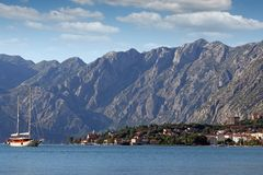Sailing boat sails through the Kotor Bay Stock Image