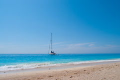 Sailing Boat and Sandy Beach Stock Photography
