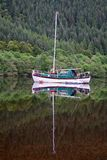 Sailing boat in Schotland. Sailing boat in a loch in Schotland Stock Photos