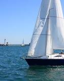 Sailing boat at sea. Sailing boat with white sails at sea Royalty Free Stock Photography