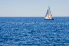 Sailing boat on the sea. Sailing boat on blue sea stock image