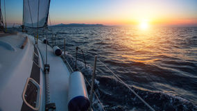 Sailing boat in the sea during a beautiful sunset. Nature. Royalty Free Stock Photos