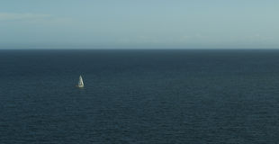 A sailing boat in the sea Royalty Free Stock Image