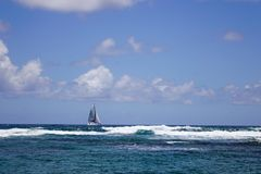 Seascape of Cap Malheureux, Mauritius. A sailing boat on the sea in Cap Malheureux, Mauritius Stock Image