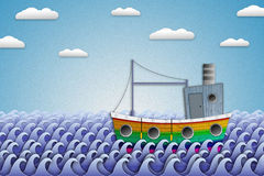 Sailing boat on the sea of paper. Stock Photos