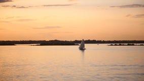 Sailing boat at sea at sunset. stock video footage