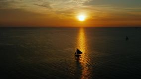Sailing boat on the sea at the sunset at Boracay island,Philippines. Sailboat against a beautiful sunset. Sailing with a beautiful sunset stock footage