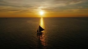 Sailing boat on the sea at the sunset at Boracay island,Philippines. Sailboat against a beautiful sunset. Sailing with a beautiful sunset stock video