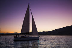 Sailing boat in the sea during twilight. Travel. Stock Photography