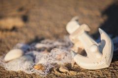 Sailing boat and seashell sand decoration closeup Stock Photo