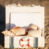 Sailing boat and seashell sand decoration closeup Stock Image
