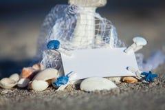 Sailing boat and seashell sand decoration closeup Royalty Free Stock Photo