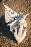 Sailing boat and seashell in sand decoration closeup Stock Photography