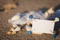 Sailing boat and seashell in sand decoration closeup Royalty Free Stock Image