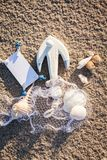 Sailing boat and seashell in sand decoration closeup Royalty Free Stock Photo