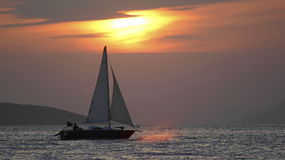 Sailing boat silhouette. Silhouette of sailing boat on adriatic sea at the coast of Dalmatia Stock Images