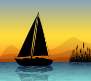 Sailing boat silhouette on a lake Royalty Free Stock Photo