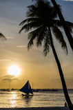 Sailing boat and silhouette of people against a beautiful sunset Royalty Free Stock Photos
