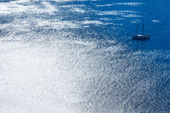 Sailing boat in silvery blue sea in Rio de Janeiro Royalty Free Stock Image