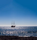 Sailing boat on silvery sea Stock Images