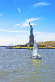 Sailing Boat and Statue of Liberty Island in Upper Bay Stock Photo
