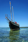 Sailing boat stranded on reef Stock Image