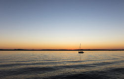 Sailing boat at summer evening Royalty Free Stock Photography