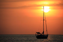 Sailing boat in the sun set. Siluate Stock Images