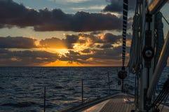 Sailing boat at sunrise in Atlantic ocean. Sailing boat's deck at sunrise. Atlantic ocean. Canary islands Royalty Free Stock Photos