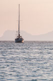 Sailing boat at sunrise Royalty Free Stock Image