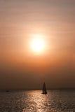 Sailing boat at sunset royalty free stock photos