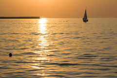 Sailing boat on sunset Royalty Free Stock Photo