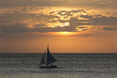 Sailing boat at sunset Stock Photo
