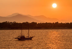 Sailing Boat at Sunset Royalty Free Stock Photo