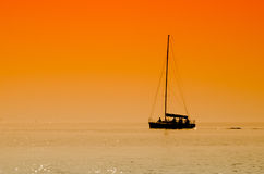 Sailing boat in sunset Royalty Free Stock Photo