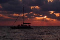 Sailing boat sunset red Royalty Free Stock Images