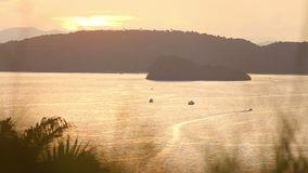 Sailing boat at sunset. Background of the islands at sunset in Thailand stock footage
