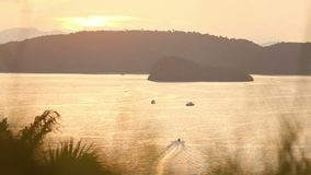 Sailing boat at sunset. Background of the islands at sunset in Thailand stock video footage