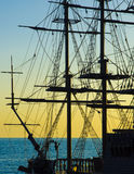 Sailing boat at sunset. Sailing ship in the background of sea and sunset Royalty Free Stock Photography