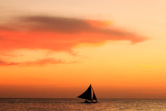 Sailing boat sunset silhouette Stock Photos