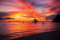 Sailing boat to the sunset in Boracay island on Royalty Free Stock Photography
