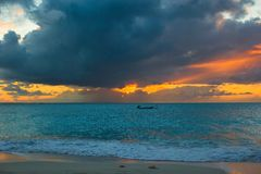 Sailing boat to the sunset in Providenciales on Turks and Caicos Royalty Free Stock Images