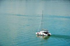 Sailing boat transiting through Panama Canal. royalty free stock photos