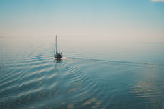 Sailing boat traveling in the open sea Royalty Free Stock Photography
