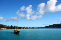 Sailing boat in turquoise blue water in the Seychelles Royalty Free Stock Photo