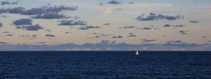 Sailing boat and vastness of the Pacific ocean Royalty Free Stock Image