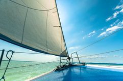 Sailing boat on the water. In sunshine Stock Image