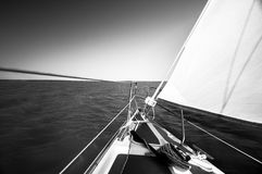 Sailing boat on the water. In sunshine Royalty Free Stock Images