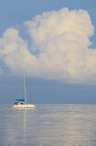 Sailing boat  and white cloud and quiet sea Stock Photos